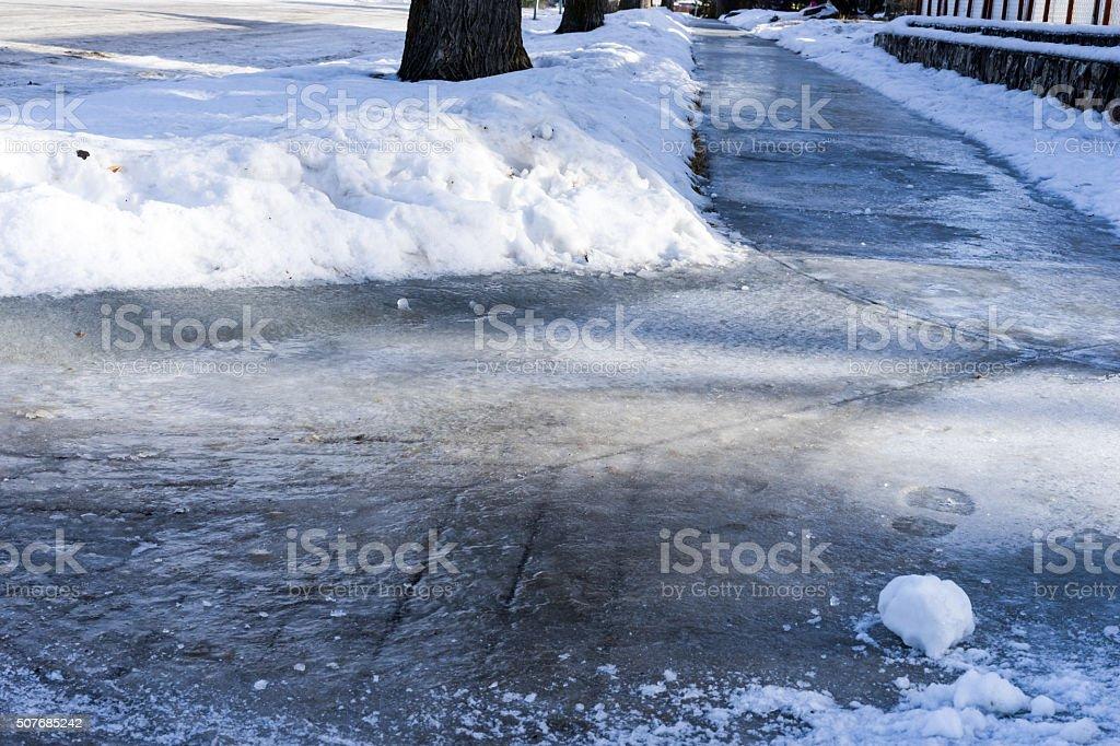Icy sidewalk stock photo