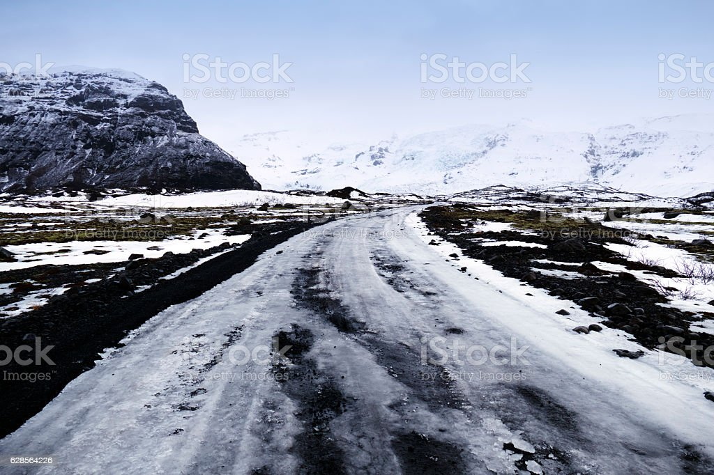 Icy slippery road in a volcanic landscape,Southeast Iceland stock photo
