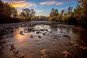 Idaho Boise River with fall leaves at sunrise
