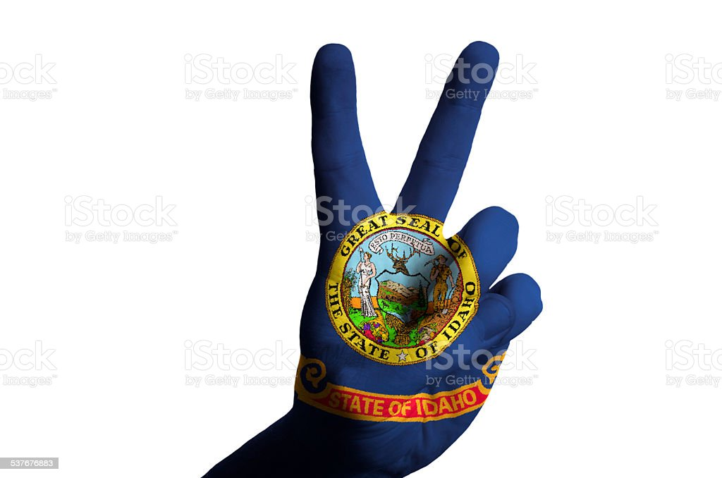 idaho us state flag two finger up gesture for victory stock photo