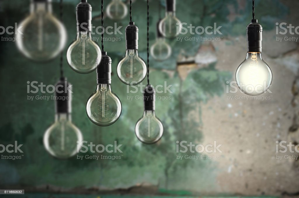 Idea and leadership concept Vintage  bulbs on wall background stock photo