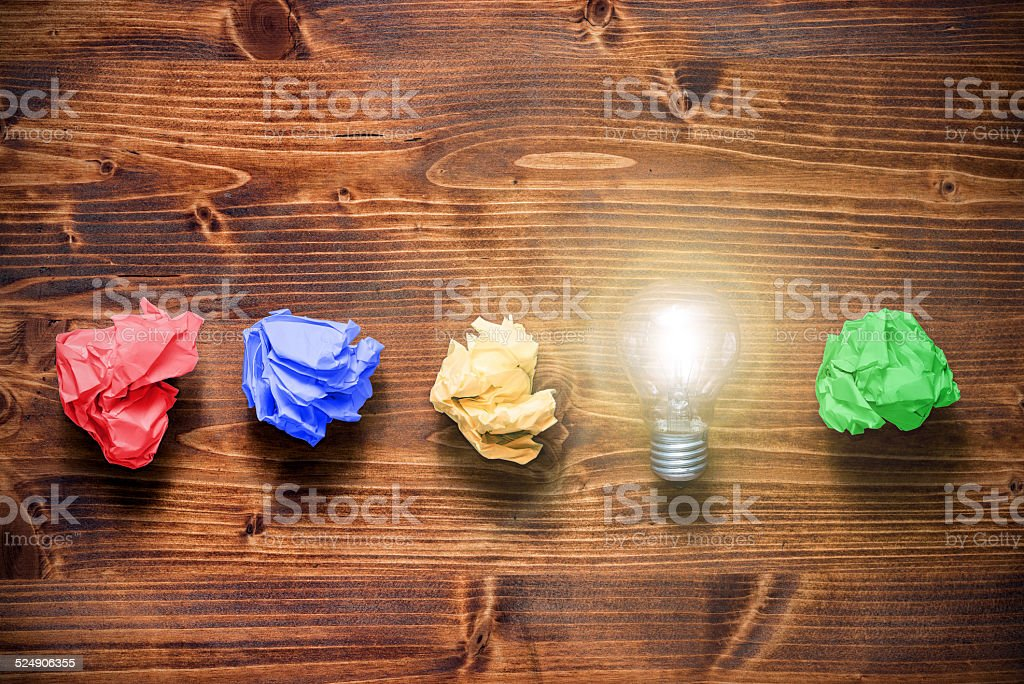 Idea bulb concept with crumpled paper stock photo