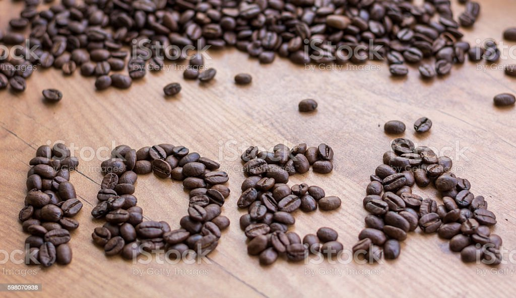Idea concept sign drawn by brown roasted coffee beans stock photo