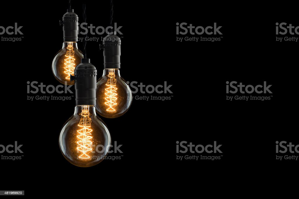Idea concept - Vintage incandescent bulbs on black background stock photo