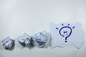 idea concept with crumpled  paper and light bulb