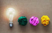 idea concept with crumpled paper light bulb