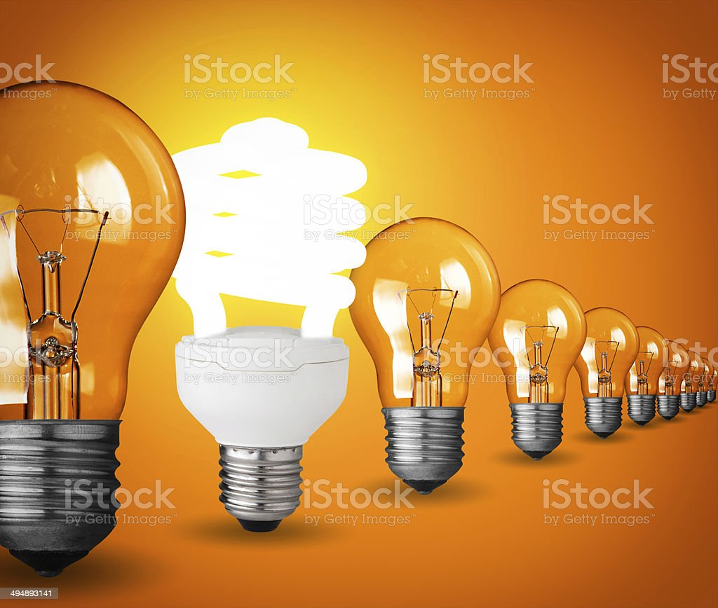 Idea concept with light bulbs on orange background stock photo