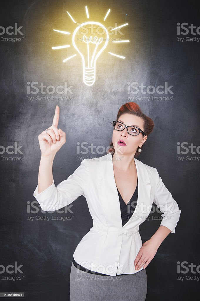 Idea concept. Woman showing on drawing lamp stock photo