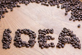 Idea conceptional sign drawn by brown roasted coffee beans