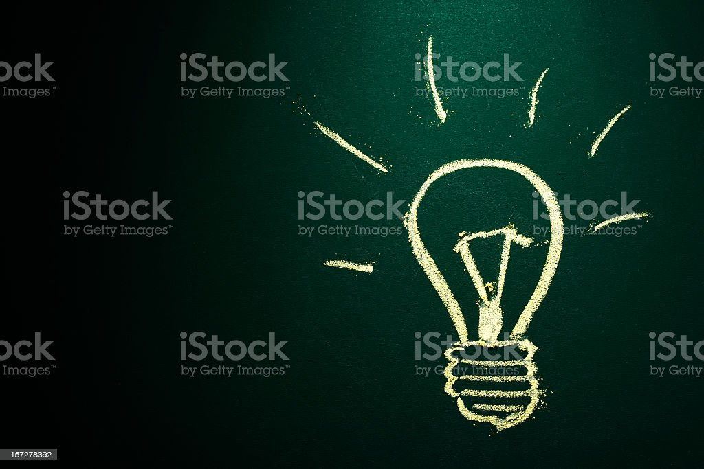 Idea in chalkboard with yellow chalk royalty-free stock photo