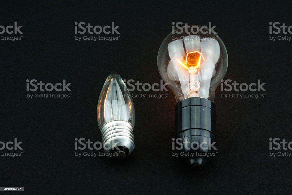Idea on black background, Light on black background. stock photo