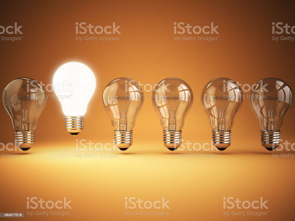 Idea or uniqueness, originality concept. Row of light bulbs with stock photo