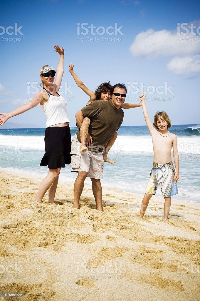 Ideal Vacation: Family on the beach in Hawaii royalty-free stock photo