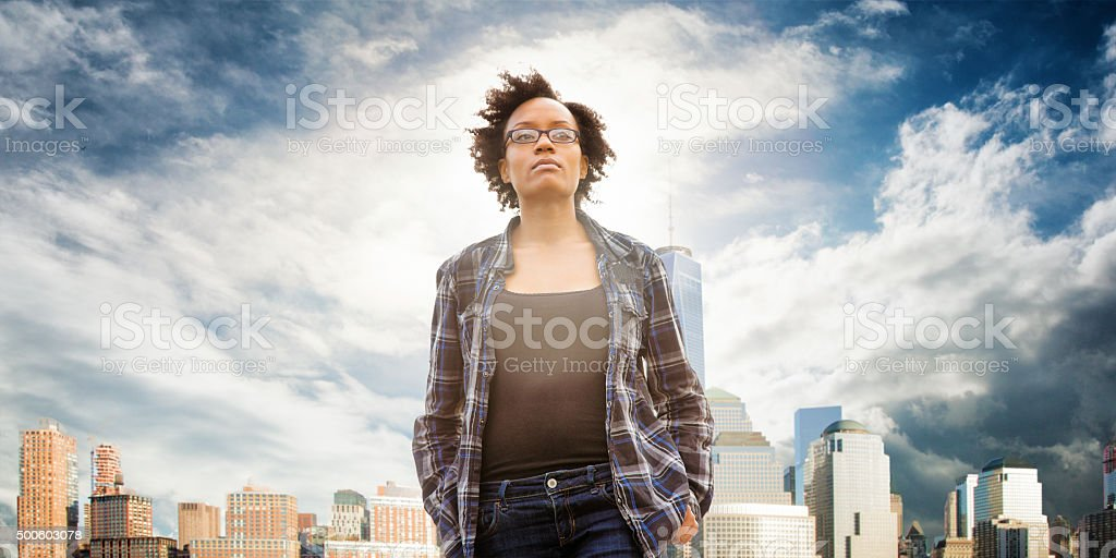 Idealistic young woman daydreaming in front of New York City stock photo