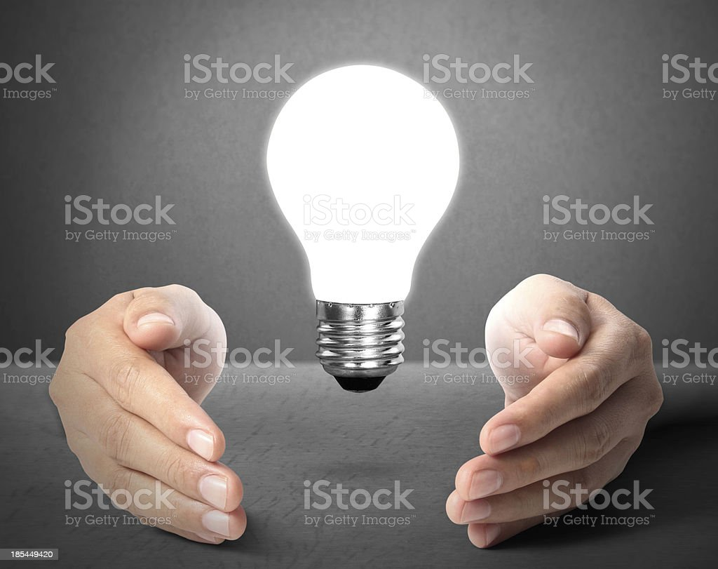 ideas light bulb in  hand royalty-free stock photo