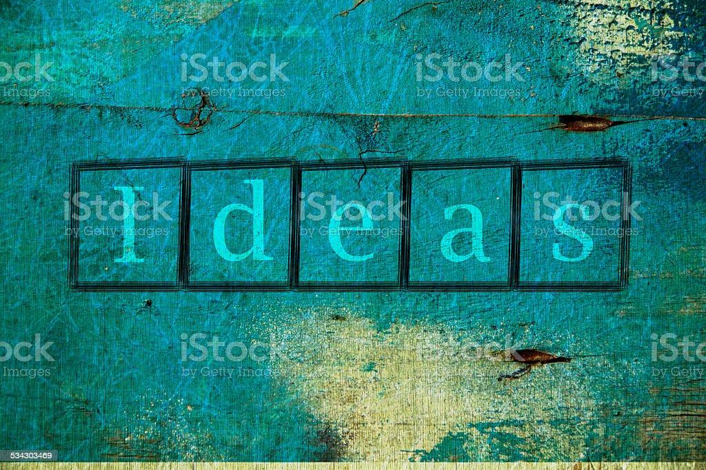 Ideas written on a wall background stock photo