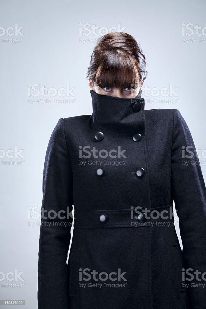 Identity Protection Woman Hides in Jacket stock photo