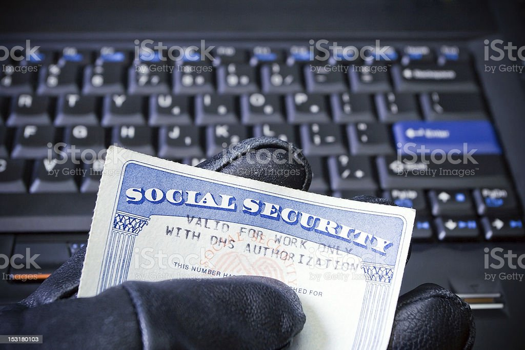 Identity theft on laptop computer stock photo