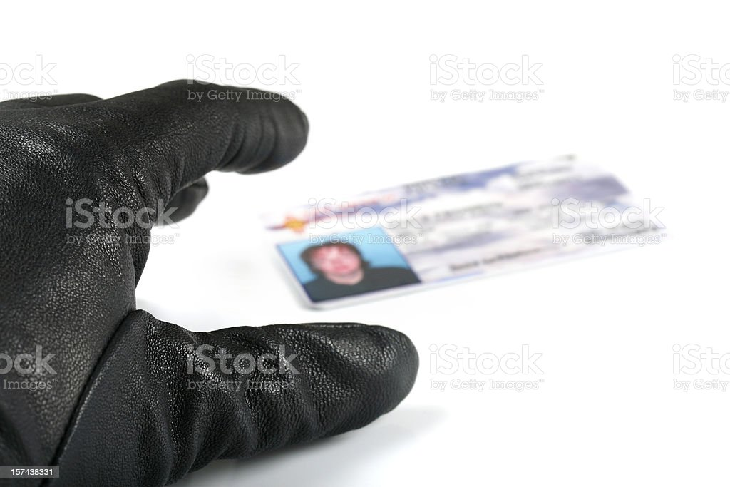 Identity Thief's Hand Reaching for I.D. royalty-free stock photo