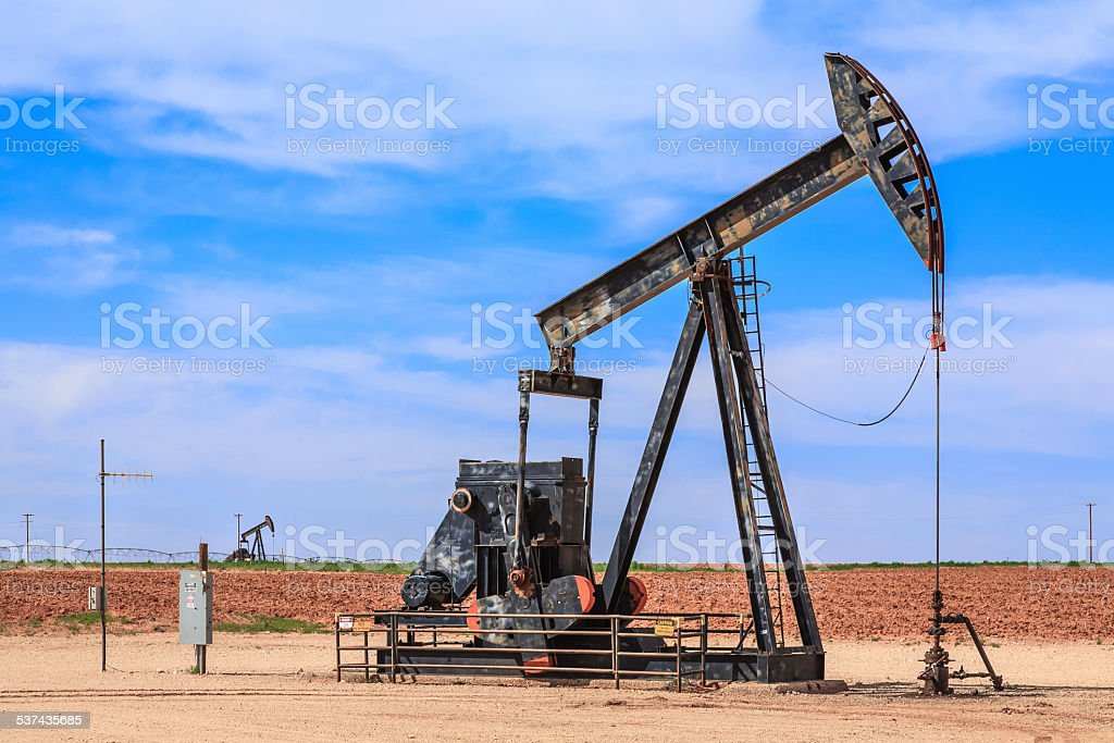 idle oil well, decommissioned inactive pumpjack, West Texas, Southwest USA stock photo
