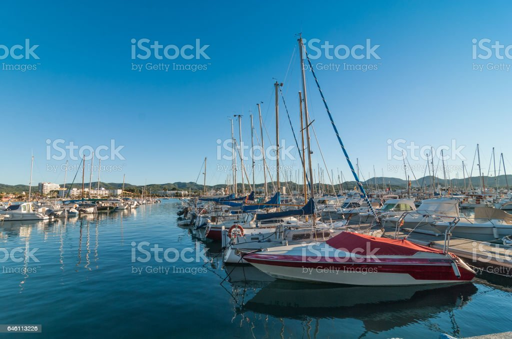 Idle sailboats and motorboats.  Boat in foreground needs paint job. stock photo