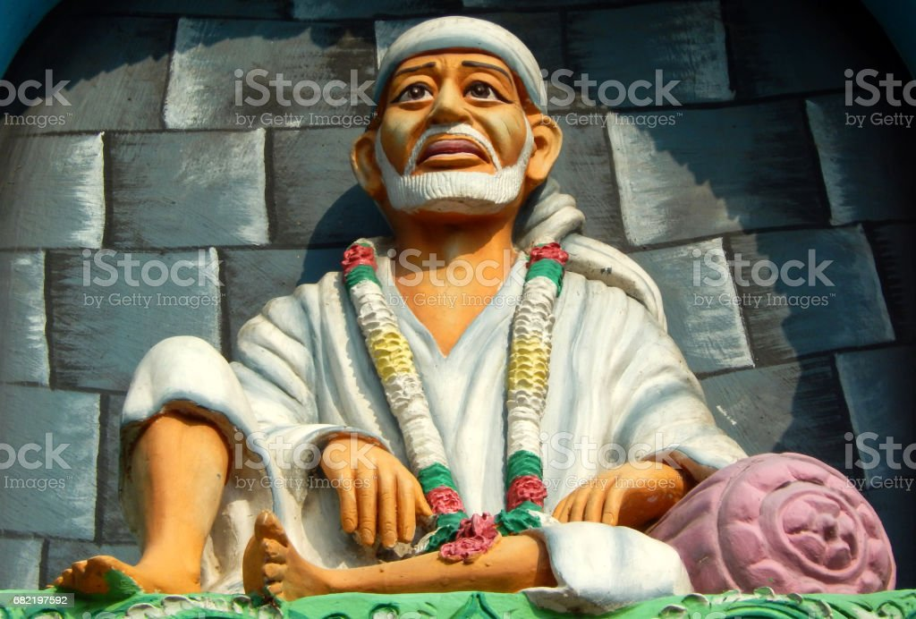 Idol of shirdi sitting on the arch of temple stock photo
