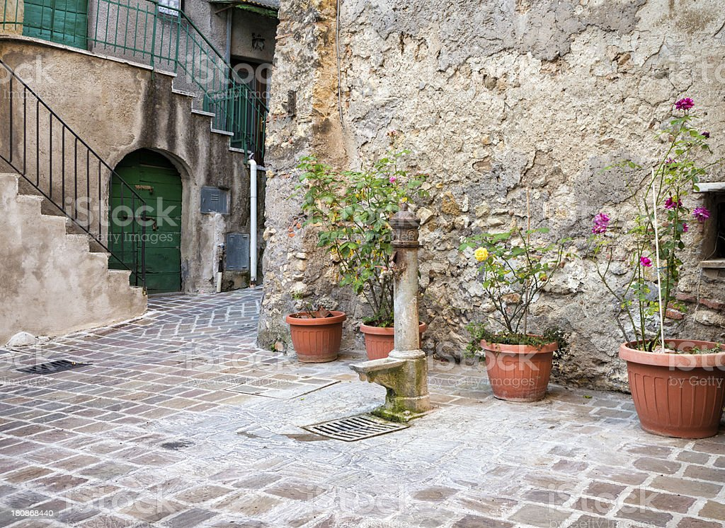 Idyllic alley with potted plants in Giove, Umbria Italy royalty-free stock photo