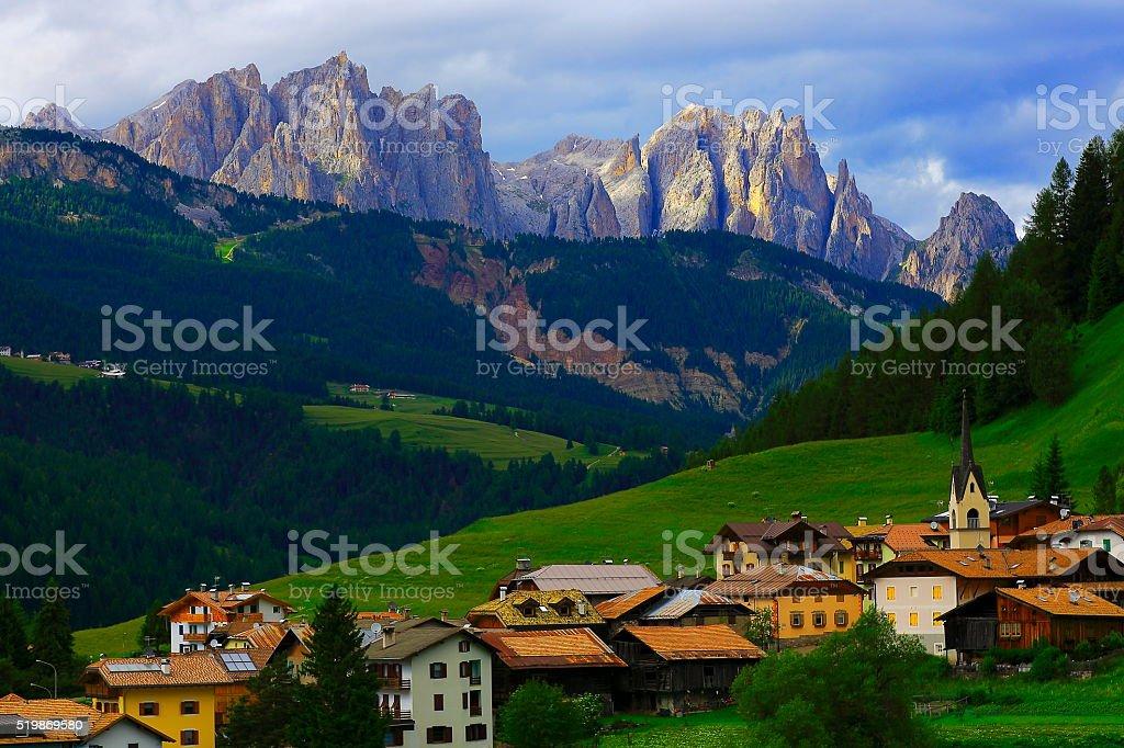 Idyllic Alpine village panorama and Langkofel, Dolomites, Italian Tirol alps stock photo