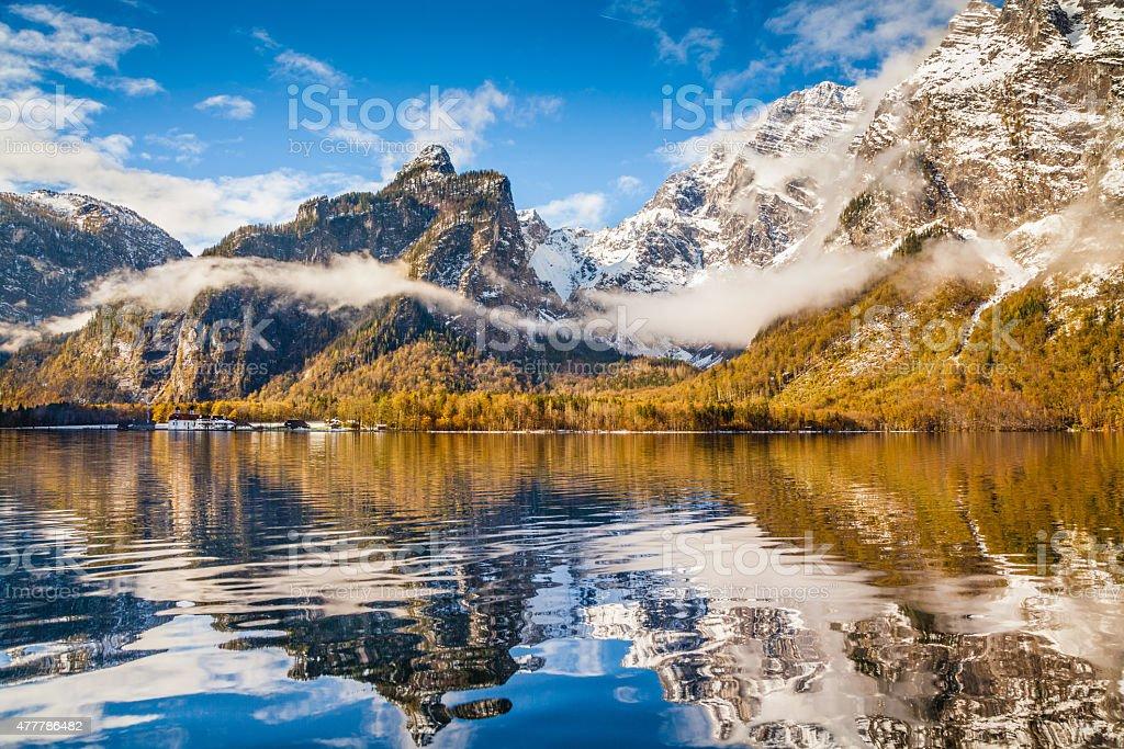 Idyllic autumn landscape with mountain lake and Alps stock photo