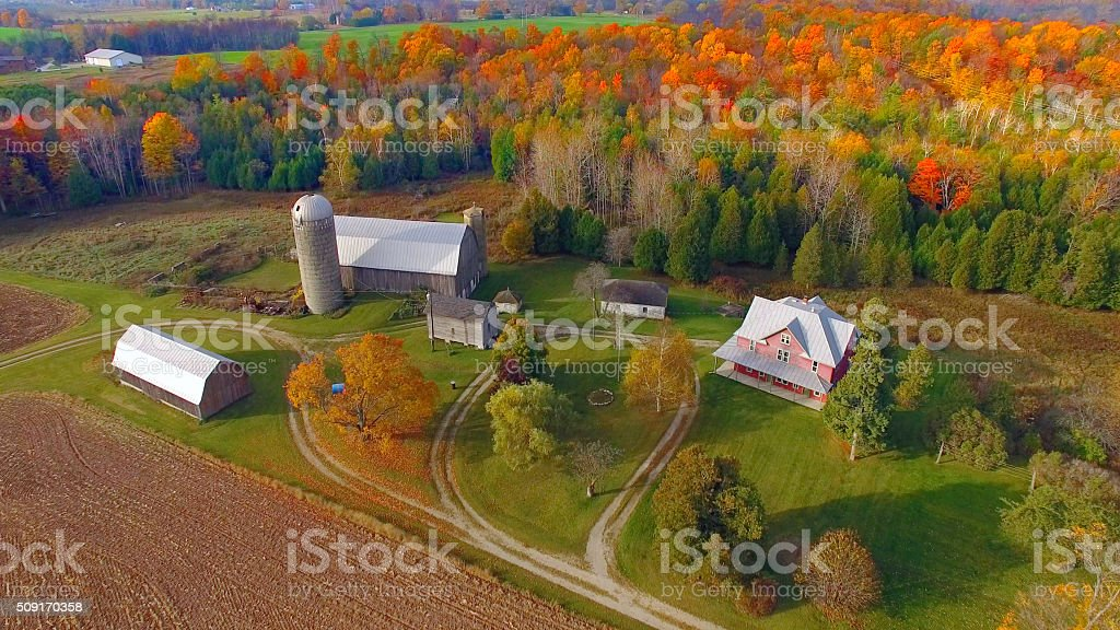 Idyllic autumn rural landscape with fiery colors stock photo