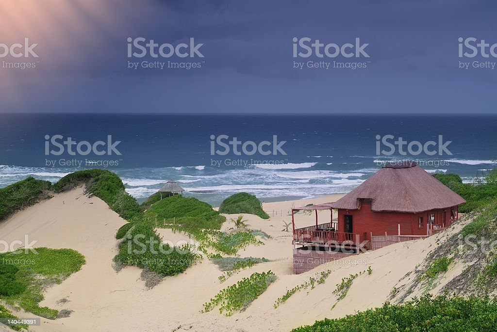 Idyllic beach cottage stock photo