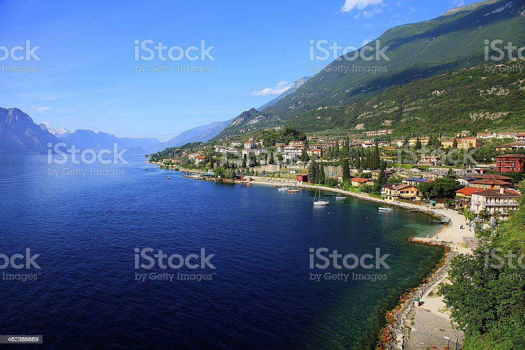 Idyllic blue Lake Garda & mountain range, Italy stock photo
