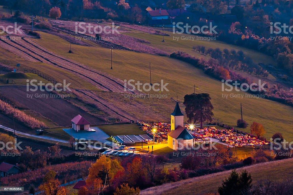 Idyllic church and graveyard evening view stock photo