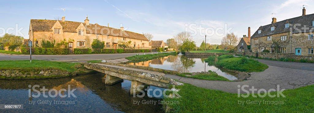 Idyllic Cotswold village reflected stock photo