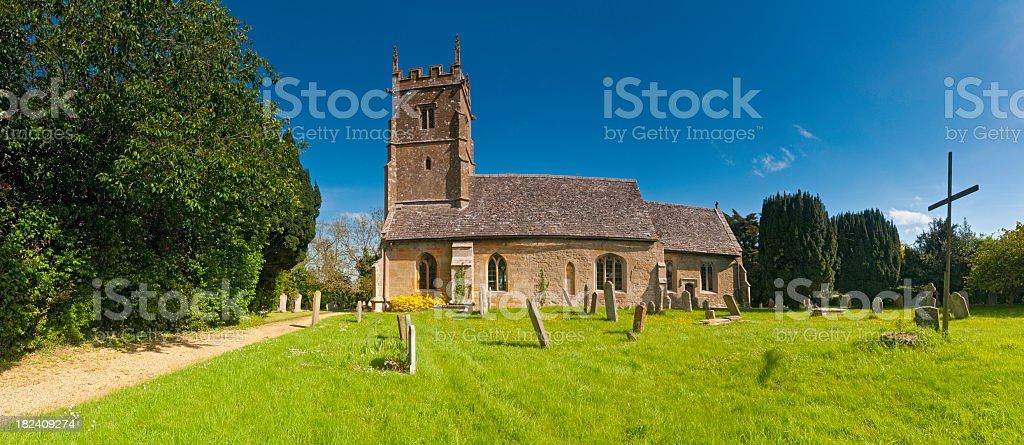 idyllic country church simple wooden cross summer panorama Cotswolds UK royalty-free stock photo