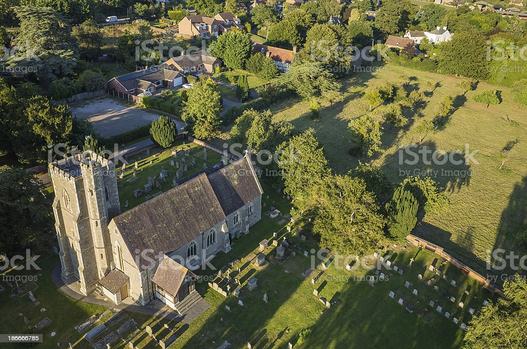 Idyllic country church village homes green fields aerial view royalty-free stock photo
