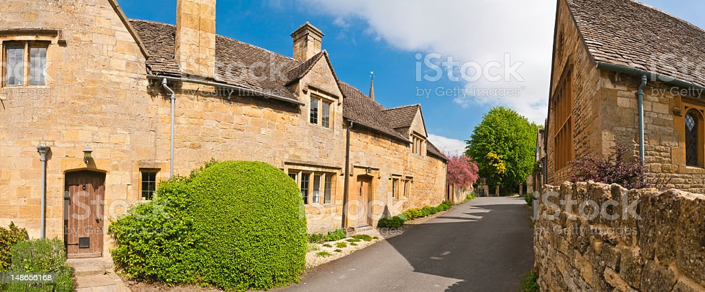 Idyllic country village cottages limestone homes quiet lane Cotswolds UK royalty-free stock photo