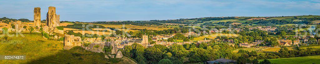 Idyllic English country village nestled in green rural valley panorama stock photo
