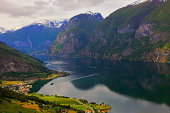 Idyllic fjord landscape panorama, dramatic sunrise, Norway, Scandinavia