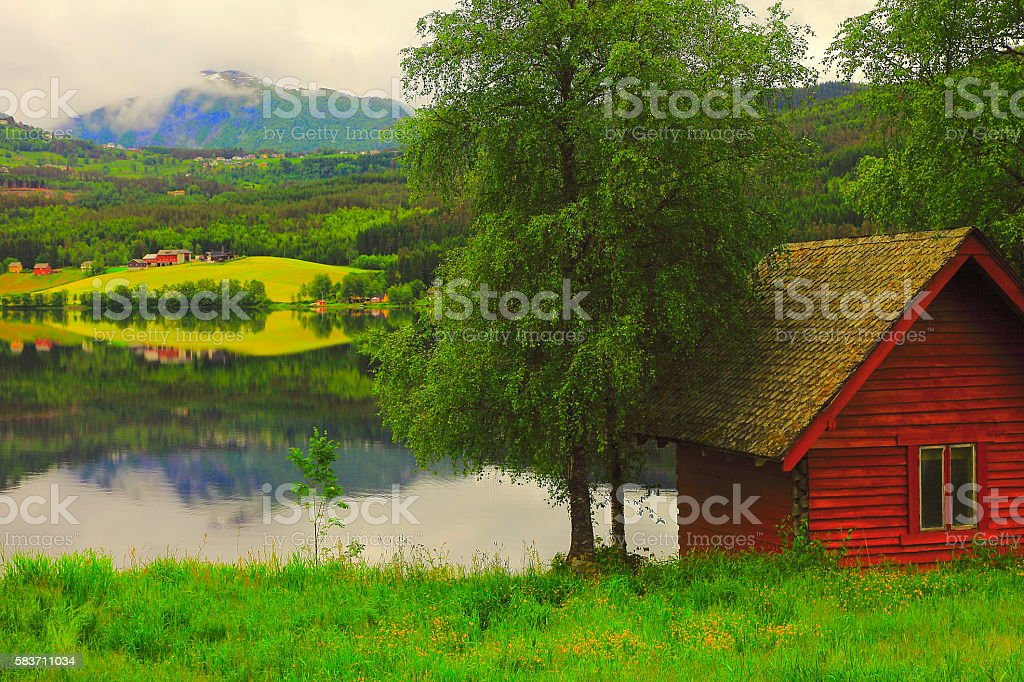 Idyllic fjord landscape, Red rorbu home, dramatic reflection, Norway, Scandinavia stock photo