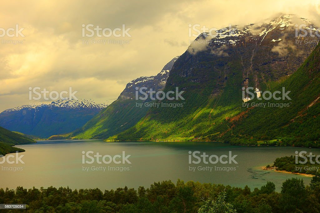 Idyllic fjord landscape reflection, dramatic sunset, Norway, Nordic Countries stock photo