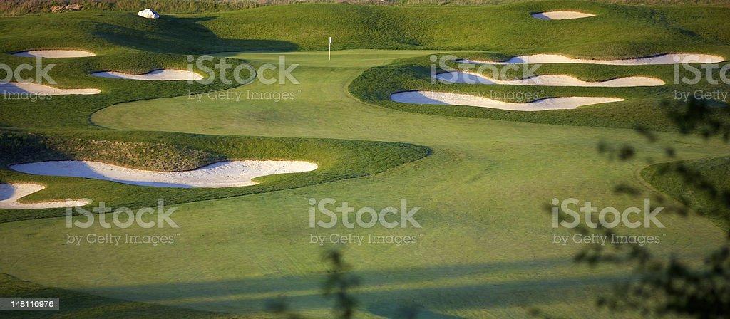 Idyllic Golf Course Hole Scene stock photo