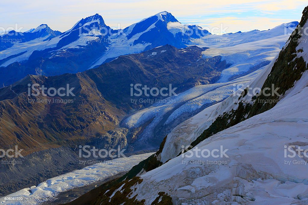 Idyllic Gornergrat, Gorner glacier crevasses dramatic sunrise, Swiss Alps stock photo