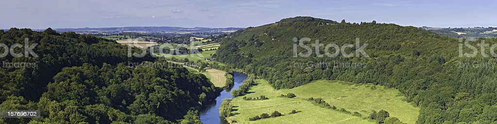 Idyllic green forest valley blue country river Symonds Yat UK stock photo