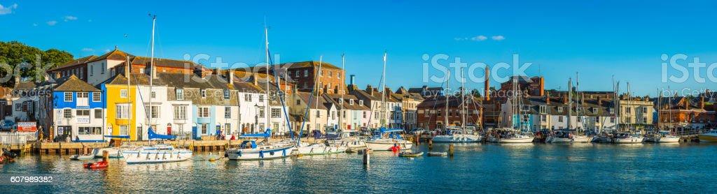 Idyllic harbour marina panorama fishing cottages tourists pubs Weymouth Dorset stock photo