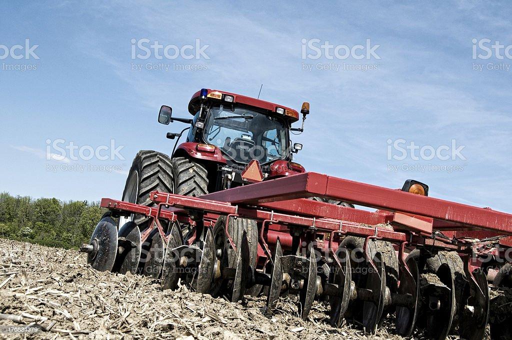 Idyllic Harvest Scene, Tractor and Plowed Field stock photo