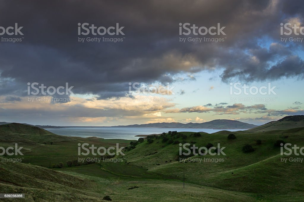 Idyllic Hillside Rolling Down to Reservoir stock photo