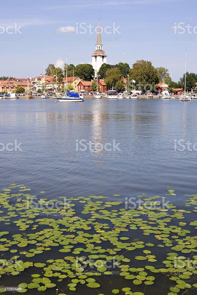 Idyllic lake and village stock photo