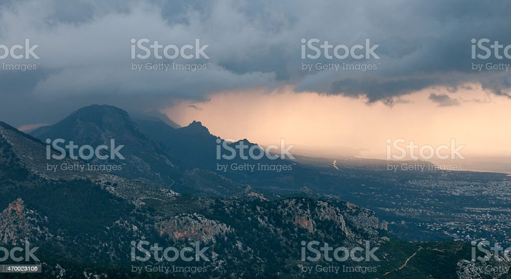 Idyllic  landscape during sunset with mountain peaks and dramatic sky stock photo