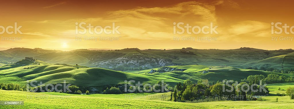 Idyllic landscape - Green fields in Tuscany at sunset stock photo